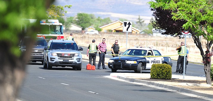 Prescott Valley Police investigate a vehicle collision with a pedestrian in the intersection of Lake Valley Road and Lakeshore Drive Monday, May 7, 2018. (Les Stukenberg/Courier)