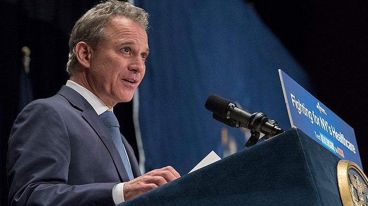 In this file photo New York Attorney General Eric Schneiderman speaks during a rally in support of the Affordable Care Act, Monday, July 17, 2017, in New York. Four women who have had romantic relationships with Schneiderman have accused him of physically abusing them. (AP Photo/Mary Altaffer)