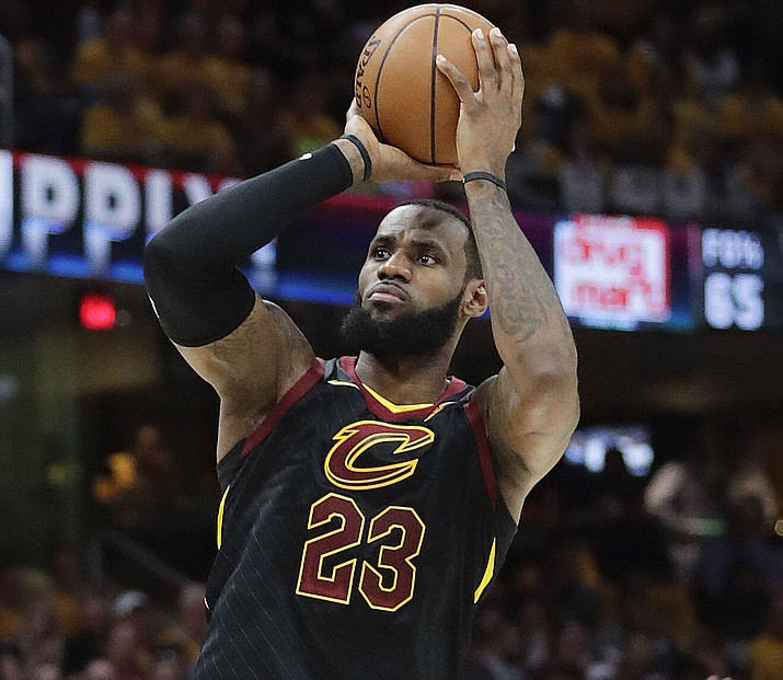 Cleveland Cavaliers' LeBron James shoots against the Toronto Raptors in the first half of Game 4 of an NBA basketball second-round playoff series, Monday, May 7, 2018, in Cleveland. (Tony Dejak/AP)