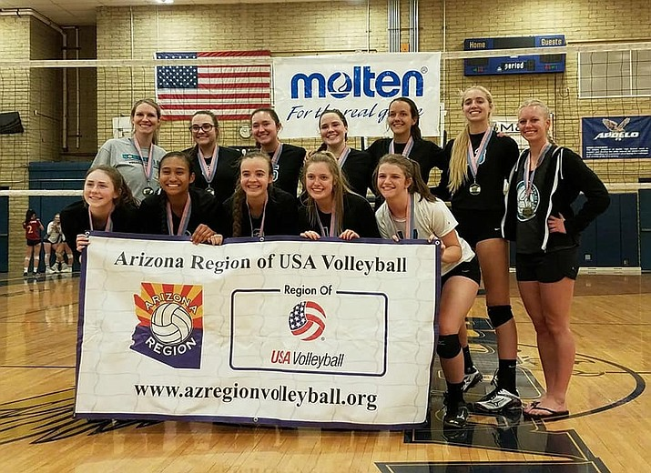 The Northern Ace Volleyball team holds up a banner and takes a team photo after finishing first overall in the Arizona region with a 29-1 overall record. (NAVA/Courtesy)