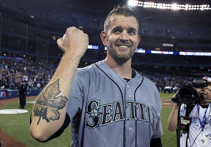 Seattle Mariners starting pitcher James Paxton shows off his Maple Leaf tattoo after pitching a no-hitter against the Toronto Blue Jays in a baseball game Tuesday, May 8, 2018, in Toronto. (Fred Thornhill/The Canadian Press via AP)