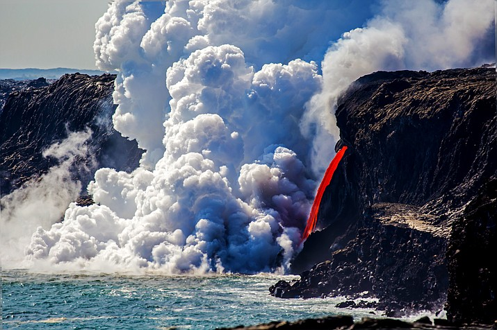 "Lava ""firehose"" enters ocean at Kamokuna in Hawaii Volcanoes National Park. (Janice Wei/NPS)"