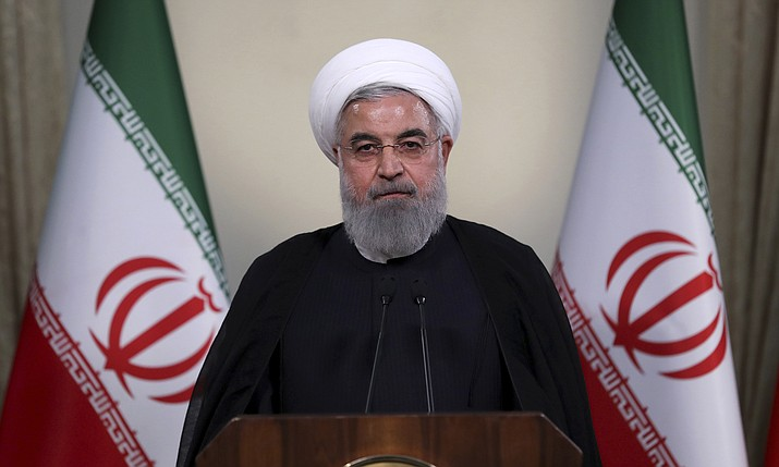 "In this photo released by official website of the office of the Iranian Presidency, President Hassan Rouhani addresses the nation in a televised speech in Tehran, Iran, Tuesday, May 8, 2018. Iranian President Hassan Rouhani said Tuesday he'd send his foreign minister to negotiate with countries remaining in the nuclear deal after Donald Trump's decision to pull America from the deal, warning he otherwise would restart enriching uranium ""in the next weeks."" (Iranian Presidency Office)"