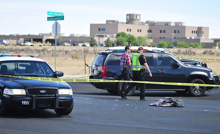 Prescott Valley Police investigate a vehicle versus pedestrian collision in the intersection of Lake Valley Road and Lakeshore Drive Monday, May 7, 2018. (Les Stukenberg/Courier)