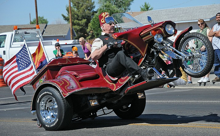 A participant entertains the crowd with a pop-a-wheely during a previous PV Days Parade. (Brett Soldwedel/Tribune, file)