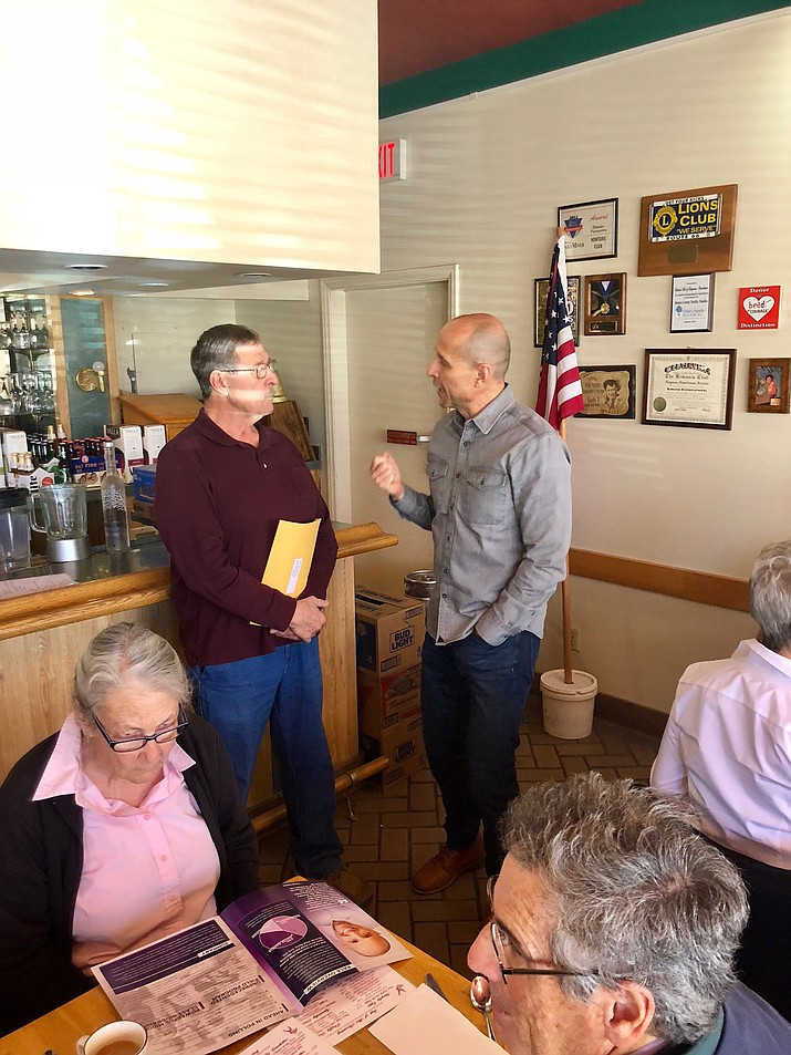 David Garcia (right) speaks with voters at Calico's when he was in Kingman in February. Garcia, Democratic candidate for governor, returns to Kingman Wednesday for a meet and greet at Beale Street Brews, 510 E. Beale St.