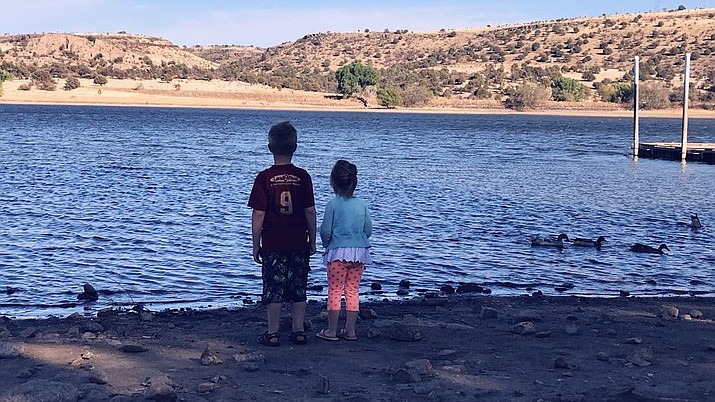 Brian M. Bergner Jr.'s two children A.J., left, and Emma, look out onto the water at Watson Lake on April 28, 2018. (Brian M. Bergner Jr./Courier)