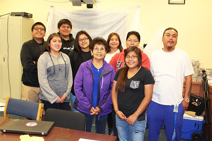 Promoters of the upcoming walk/run against domestic violence spoke with students in the Hopi High radio class. From left: (top row) Trained Tootsie, Ty Lilly, Mariah Qumyintewa, Jacque Thorpe, Meranda Lomayaktewa and Zack George; and (bottom row) Lakota Lomakema, Florence Choyou and Mallory Nutumya. (Stan Bindell/NHO)