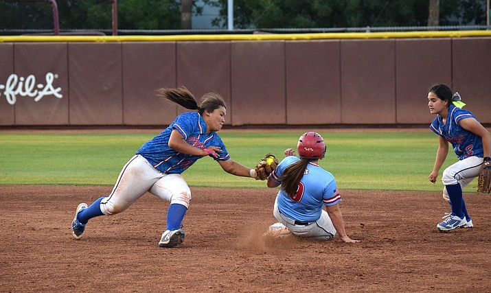 Camp Verde freshman Jenna Huey tries to tag a Benson runner during the Bobcats' 7-3 win over the Cowboys in the state championship game on Tuesday in Tempe. (VVN/James Kelley)