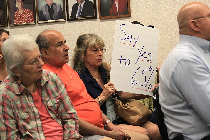 In an unusual move for citizens, many attended Cottonwood's work session Tuesday with signs advocating for a .65 percent sales tax increase. VVN/Kelcie Grega