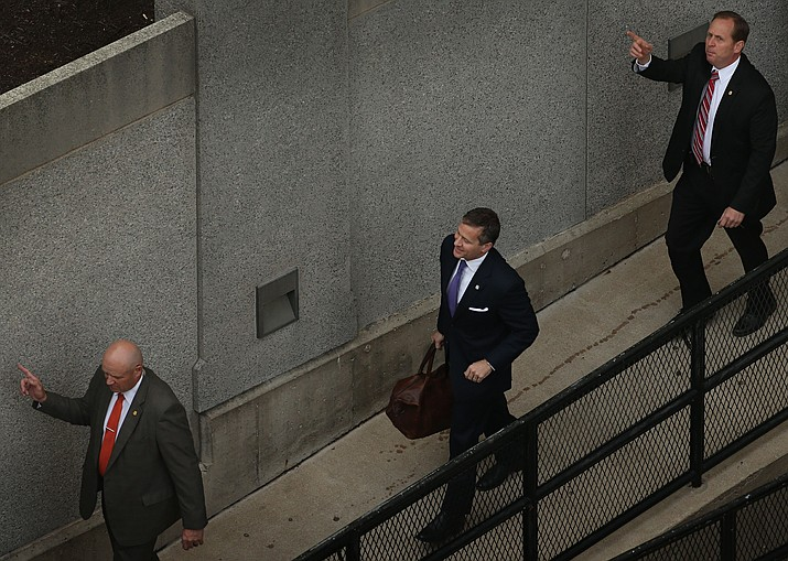 Flanked by security guards, Missouri Gov. Eric Greitens, center, arrives at court for jury selection in his felony invasion of privacy trial, Thursday, May 10, 2018, in St. Louis. Greitens is accused of taking an unauthorized and compromising photo of a woman with whom he had an affair. (David Carson/St. Louis Post-Dispatch)