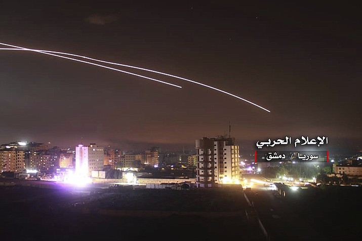 """This photo provided early Thursday, May 10, 2018, by the government-controlled Syrian Central Military Media, shows missiles rise into the sky as Israeli missiles hit air defense position and other military bases, in Damascus, Syria. The Israeli military on Thursday said it attacked """"dozens"""" of Iranian targets in neighboring Syria in response to an Iranian rocket barrage on Israeli positions in the Golan Heights, in the most serious military confrontation between the two bitter enemies to date. (Syrian Central Military Media)"""