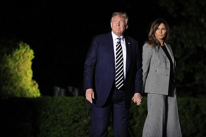 President Donald Trump, with first lady Melania Trump, leaves the White House in Washington, early Thursday, May 10, 2018, to greet three freed Americans detained in North Korea for over a year, who are arriving at Andrews Air Force Base, Md. (AP Photo/Manuel Balce Ceneta)