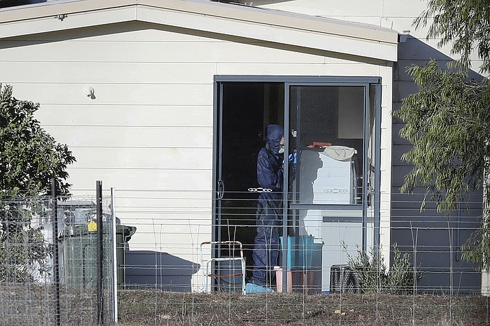 Police forensics investigate the death of seven people in a suspected murder-suicide in Osmington, east of Margaret River, south west of Perth, Australia Friday, May 11, 2018. Seven people including four children were found dead with gunshot wounds Friday at a rural property in southwest Australia in what could be the country's worst mass shooting in 22 years, police said. (Richard Wainwright/AAP Image)