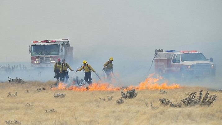 The Viewpoint Fire started along Highway 89a in Prescott Valley Friday morning. The fire, driven by a sustained wind, headed north into the Poquito Valley area. (Les Stukenberg/Courier)