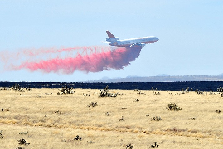 A DC-10 drops a load of retardant along the western edge of the Viewpoint Fire that started along Highway 89A in Prescott Valley on Friday, May 11, 2018. The fire, driven by a sustained wind, headed north into the Poquito Valley area. (Les Stukenberg/Courier)