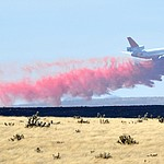 A DC-10 drops a load of retardant along the western edge of the Viewpoint Fire that started along Highway 89A in Prescott Valley Friday morning, May 11, 2018. The fire, driven by a sustained wind, headed north into the Poquito Valley area. (Les Stukenberg/Courier)
