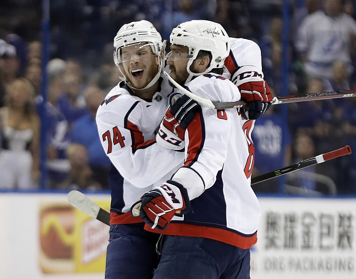 Washington Capitals left wing Alex Ovechkin (8) celebrates his goal against the Tampa Bay Lightning with defenseman John Carlson (74) during the first period of Game 1 of an NHL Eastern Conference final hockey playoff series Friday, May 11, 2018, in Tampa, Fla. (Chris O'Meara/AP)