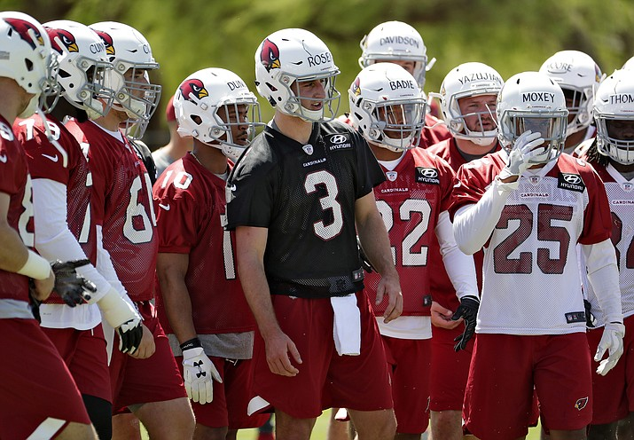 Arizona Cardinals' first-round draft pick Josh Rosen (3) stands with his teammates during NFL football rookie camp Friday, May 11, 2018, in Tempe. (Matt York/AP)