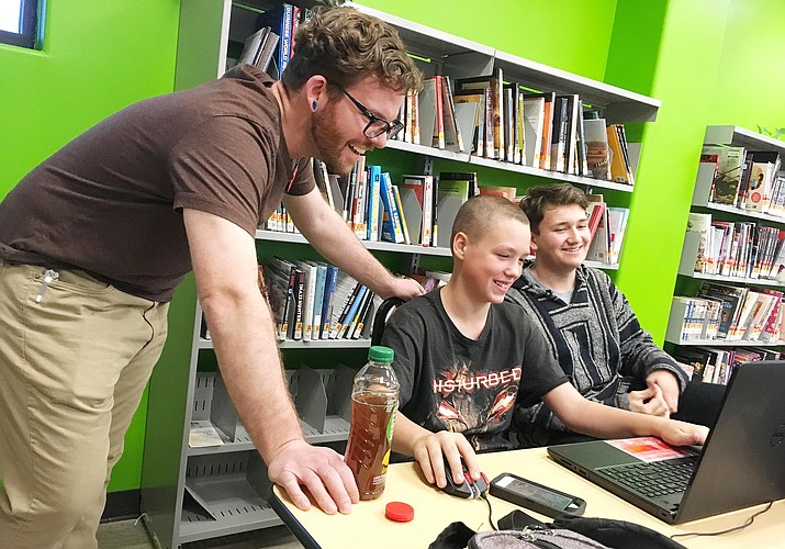 Teen Librarian Zack Garcia is now full-time at the Camp Verde library. Garcia is pictured with 13-year-old Brice Gorda and 15-year-old Jonah Ray. (Photo by Bill Helm)