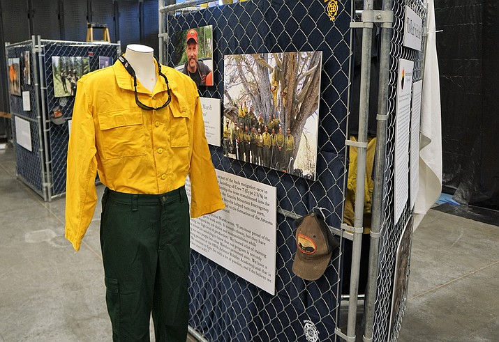 As a part of the display in the new Granite Mountain Interagency Hotshot Crew Learning and Tribute Center at the Prescott Gateway Mall, each of the 19 fallen Hotshots is being commemorated on chain-link-fence replicas of the tribute that developed on the fence surrounding Prescott's Fire Station 7, the Sixth Street home of the Hotshots. The community left thousands of items to honor the Hotshots after the June 2013 tragedy. (Cindy Barks/Courier)