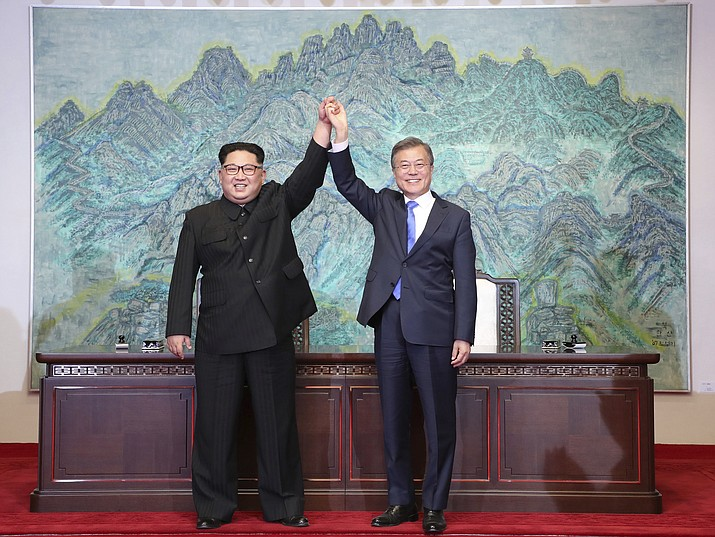 "In this Friday, April 27 file photo, North Korean leader Kim Jong Un, left, and South Korean President Moon Jae-in raise their hands after signing on a joint statement at the border village of Panmunjom in the Demilitarised Zone, South Korea. North Korea's Foreign Ministry said Saturday May 12, 2018, it will hold a ""ceremony"" for the dismantling of its nuclear test site on May 23-25 in what would be a dramatic but symbolic event to set up the summit meeting between Kim Jong Un and US President Donald Trump scheduled for next month.(Korea Summit Press Pool via AP, File)"