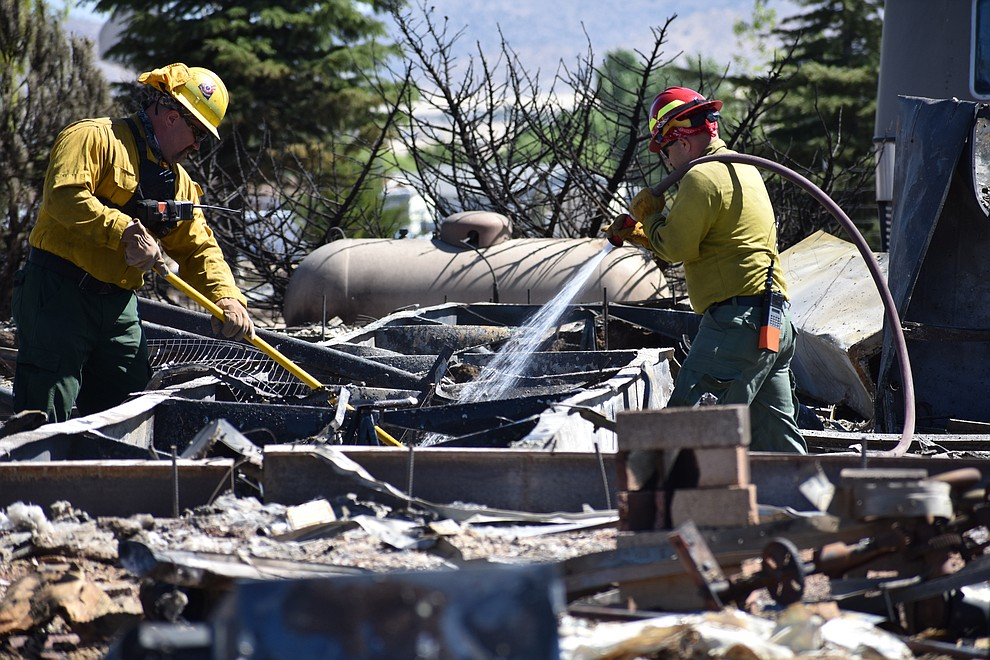 On the morning of May 12, 2018, fire crews put out hot spots on a home destroyed a day earlier by the Viewpoint Fire in the 7000 block of Whisper Ranch Road in the Poquito Valley community of Prescott Valley, Arizona. (Richard Haddad/WNI)