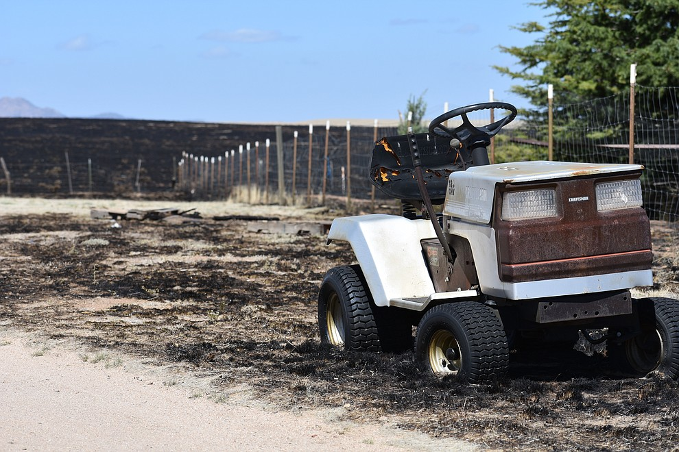 A riding lawn mower with its wheels melted sits in the yard of a home that was destroyed by the May 11, 2018, Viewpoint Fire in the Poquito Valley area of Prescott Valley, Arizona. (Richard Haddad/WNI)