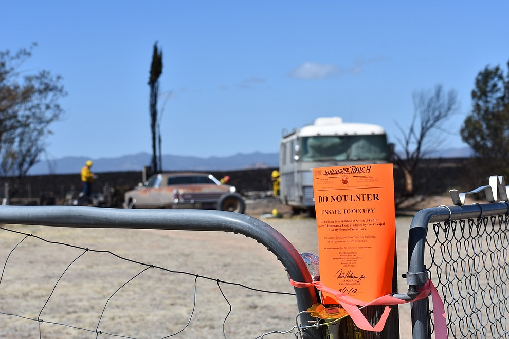 A Yavapai County Development Services notice is seen at the entrance gate of a home destroyed by the May 11, 2018 Viewpoint Fire in the 7000 block of Whisper Ranch Road in the Poquito Valley community of Prescott Valley, Arizona. (Richard Haddad/WNI)