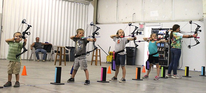 From left, Lincoln Rowden, Kase Bryant, Tenley Rowden, Kena Bryant and Marlainna Knowles take practice shots Thursday at the Mohave County Fairgrounds.