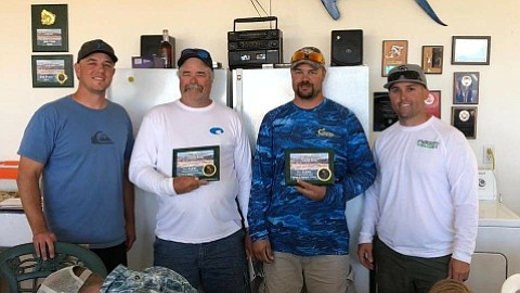 KFFA tournament director Matt Wolsey (far left) along with Fred Proudfoot and his son Mark Proudfoot and Director Mike Stapleton (far right) are all smiles as the father/son were awarded the prize for winning the bass portion of the KFFA tournament on Saturday at Lake Mead. (Photo special to the Daily Miner)