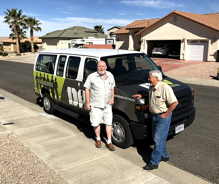 Kingman DAV coordinator Bill Wallace (left) and Jerry Tacorante stand outside one of the DAV vans in the Daily Miner file photo from April 2017. Wallace reports in his Thank You letter that DAV is on track to purchase a new van in the next few months. (Daily Miner file photo)
