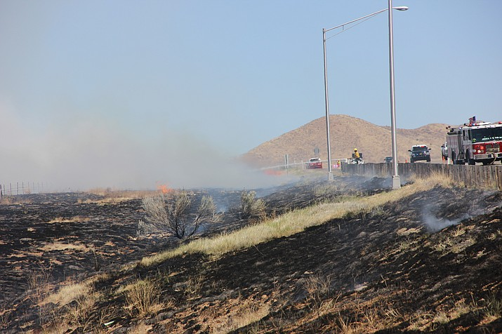 Area firefighter crews work to extinguish a wind-driven wildland fire along Fain Road in Prescott Valley Monday, May 14.