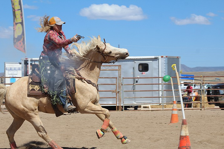 Melissa Ambrose of the Arizona Cowboy Mounted Shooters shows off what she can do at the inaugural Big Q event at the Chino Valley Equestrian Center on Saturday, May 12. (Candace Sheridan/Courtesy)