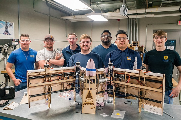 Undergrad engineering students at Embry-Riddle Aeronautical University proudly stand behind an innovative design they created for an autonomous aerial vehicle. Their work ultimately resulted in two patentable concepts for innovative aerodynamic configurations and the mechanisms needed for those configurations. (ERAU/Courtesy)