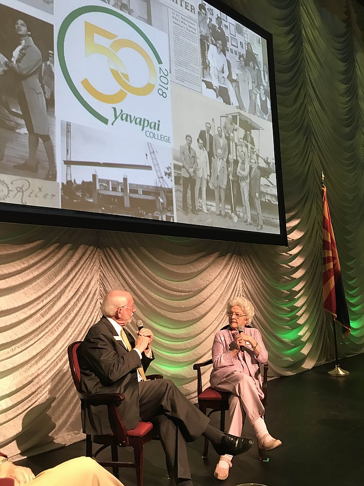 Paul Kirchgraber, left, of the Yavapai College Foundation, is pictured Wednesday, May 9, 2018, at the Yavapai College annual meeting, held at the college's performing arts center. Kirchgraber discussed local history with Jean Phillips, also pictured. She is an emeritus board member and created the college's first endowed nursing scholarship. (Kelly Soldwedel/Courier)