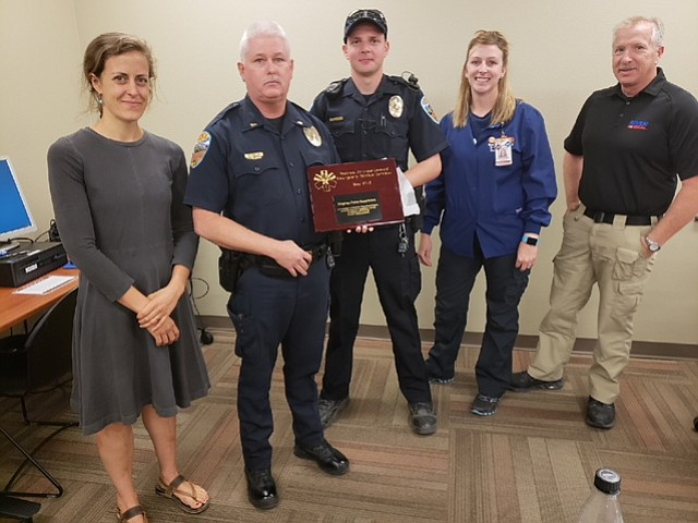 Kingman Police Department received an award for its NARCAN drug overdose program. From left are Stefan Merrill, director of emergency medicine at KRMC; Kingman Police Lt. Mark Chastain; police officer Shawn Wyma; Heather Miller, trauma manager at KRMC; and Chuck Waalkens, supervisor of AMR ambulance.