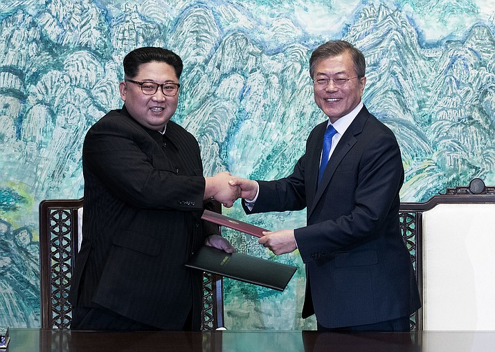 In this April 27, 2018 file photo, North Korean leader Kim Jong Un, left, and South Korean President Moon Jae-in shake hands after signing on a joint statement at the border village of Panmunjom in the Demilitarized Zone, South Korea. The two Koreas will hold a high-level meeting on Wednesday, May 16, 2018, to discuss setting up military and Red Cross talks aimed at reducing border tension and restarting reunions between families separated by the Korean War. (Korea Summit Press Pool)