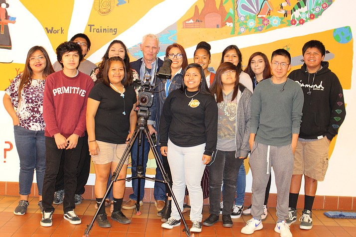 Hopi High video students surround filmmakers Jon Bang Carlsen and Jhane Myers during a recent visit to Hopi High School. From left, (back row) Ty Lilly, Serena Leslie, Amber Labahe, Stacy Charley, Carlsen, Myers, Ellense Sahmea, Andrew Honahnie and Cheyanne Rodriguez; and (bottom row) Loma Youvella, Megan Kaye, Myra Mahle, Bianca Phillips and Kiiyahno. (Stan Bindell/NHO)
