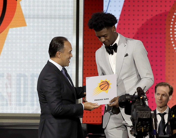 NBA Deputy Commissioner Mark Tatum, left, congratulates Phoenix Suns forward Josh Jackson after Tatum announced that the Suns had won the first pick for the NBA basketball draft, during the draft lottery Tuesday, May 15, 2018, in Chicago. (Charles Rex Arbogast/AP)