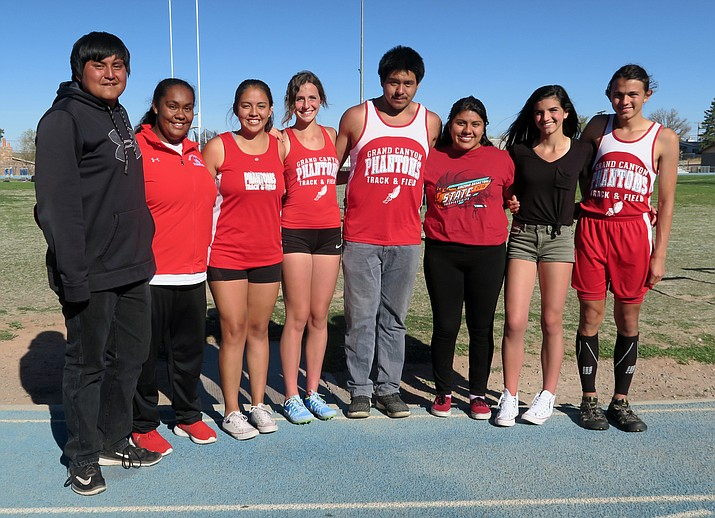 Senior track and field athletes (from left) Herman Yellowhair, Meme Jeter-Nanacasia, Tyra Briones, Savannah Perkins, Neegoh Kaska, Monica Dimas-Gonzales, Emma Perkins and Cale Wisher. (Photo/Kim Besom)