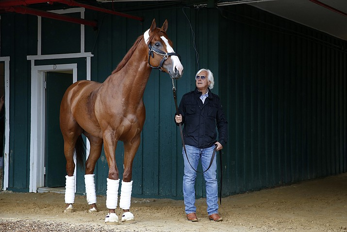 Trainer Bob Baffert walks Kentucky Derby winner Justify in a barn, Wednesday, May 16, 2018, after arriving at Pimlico Race Course in Baltimore. The Preakness Stakes horse race is scheduled to take place Saturday, May 19. (AP Photo/Patrick Semansky)
