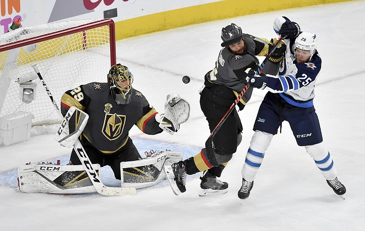 Vegas Golden Knights goaltender Marc-Andre Fleury, left, and defenseman Deryk Engelland, middle, defend against Winnipeg Jets center Paul Stastny during the second period of Game 3 of the NHL hockey playoffs Western Conference finals Wednesday, May 16, 2018, in Las Vegas. (AP Photo/David Becker)