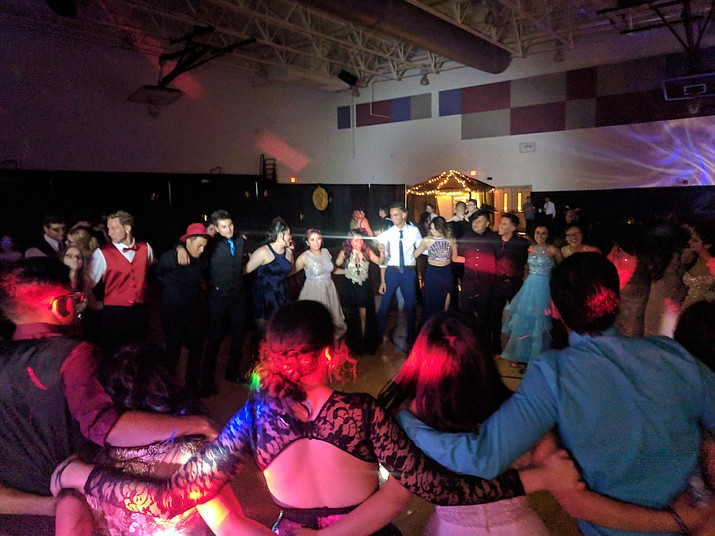 Bradshaw Mountain High School held their Mystic Midnight Prom 2018 on Saturday, April 28, 2018 at the East Campus gym. It was attended by nearly 400 students, who enjoyed an evening of dancing to music provided by DJ Big Poppa. Attendees were excited that the Prescott Valley Dutch Bros. team came to serve 400 free drinks. Although officially closed due to a teacher walkout, more than 30 staff members showed up to volunteer their time. The sets were constructed by the Student Council and Prom Committee. Our Prom King and Queen were Omar Mejia and Alex Fabela. (Courtesy)