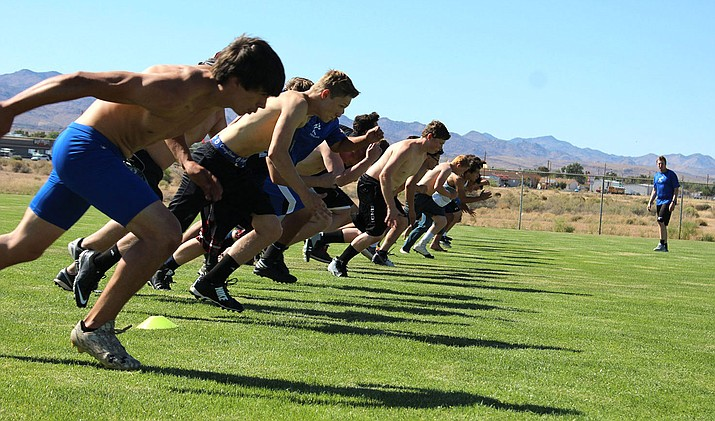 The Kingman High School football team runs sprints Tuesday afternoon during spring practice at KHS.