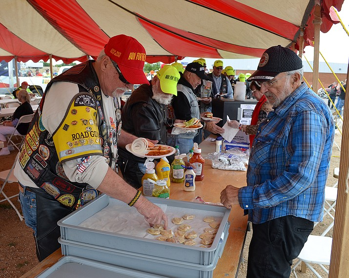 Run for the Wall participants constructing well-deserved lunches at Mother Road Harley-Davidson last year. The run is back in Kingman Wednesday, May 16 with more 1,000 riders coming into town.
