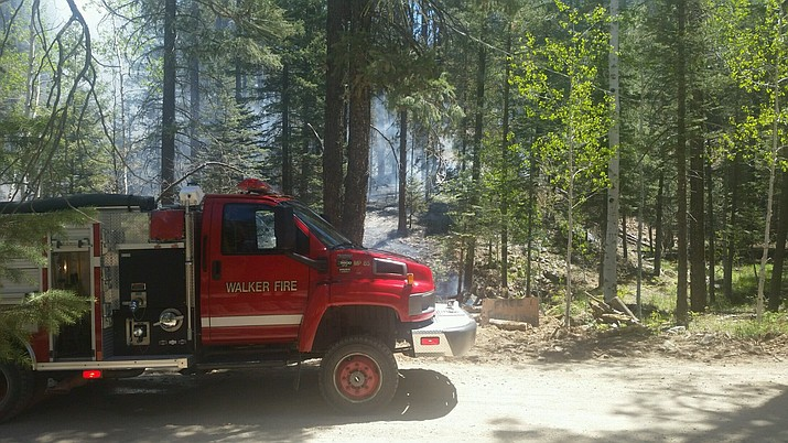 Multiple firefighting agencies are working to contain a wildfire near Walker.