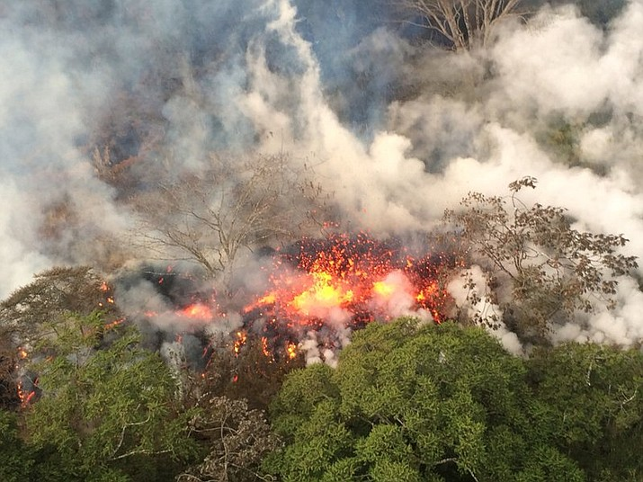 This Wednesday, May 16, 2018, image provided by the U.S. Geological Survey shows lava spattering from an area between active Fissures 16 and 20 photographed at 8:20 a.m. HST, on the lower east rift of the Kilauea volcano, near Pahoa, Hawaii. Plumes range from 1 to 2 kilometers (3,000 to 6,000 feet) above the ground. Officials say some vents formed by Kilauea volcano are releasing such high levels of sulfur dioxide that the gas poses an immediate danger to anyone nearby. (U.S. Geological Survey)