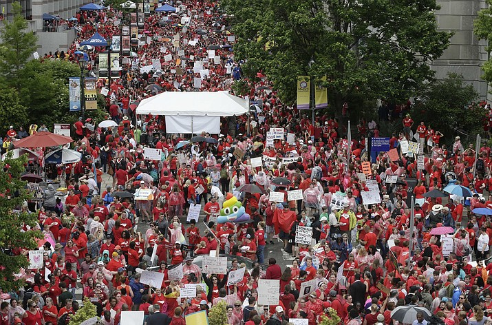 Teachers gather outside the Senate and House chambers during a teachers rally at the General Assembly in Raleigh, N.C., Wednesday, May 16, 2018. Thousands of teachers rallied the state capital seeking a political showdown over wages and funding for public school classrooms. (AP Photo/Gerry Broome)