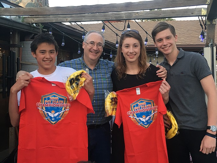 From left to right: Jayden Long, head coach Bill Riviere, Renee Baillie and Josh Baillie pose for a photo at after the 2018 May Dayz Meet on April 28 and 29 in Chandler. Long, Renee and Josh have qualified for the state championship meet in late July. (Prescott Swim Team/Courtesy)